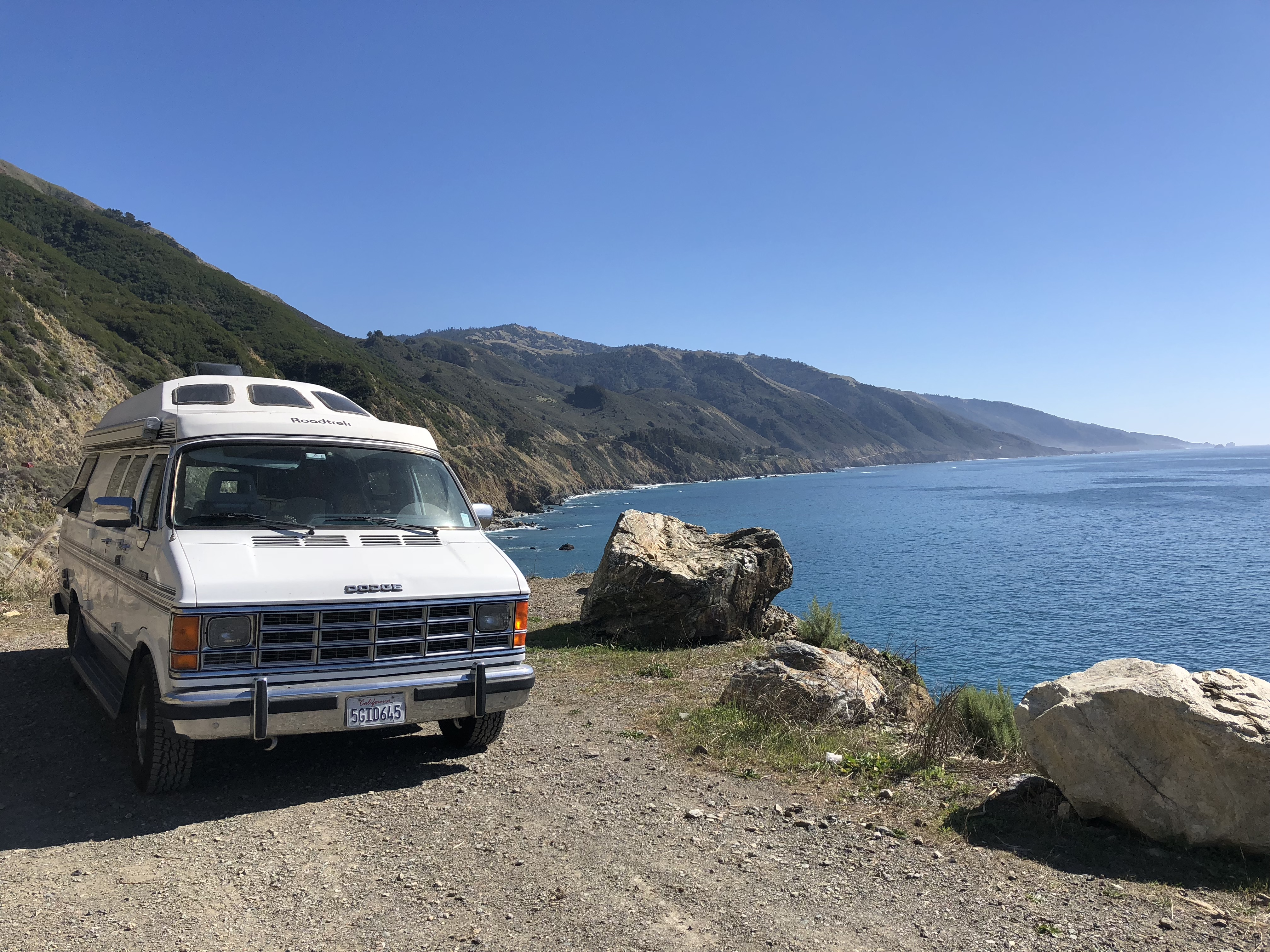 A van parked in a turnout on Highway 1