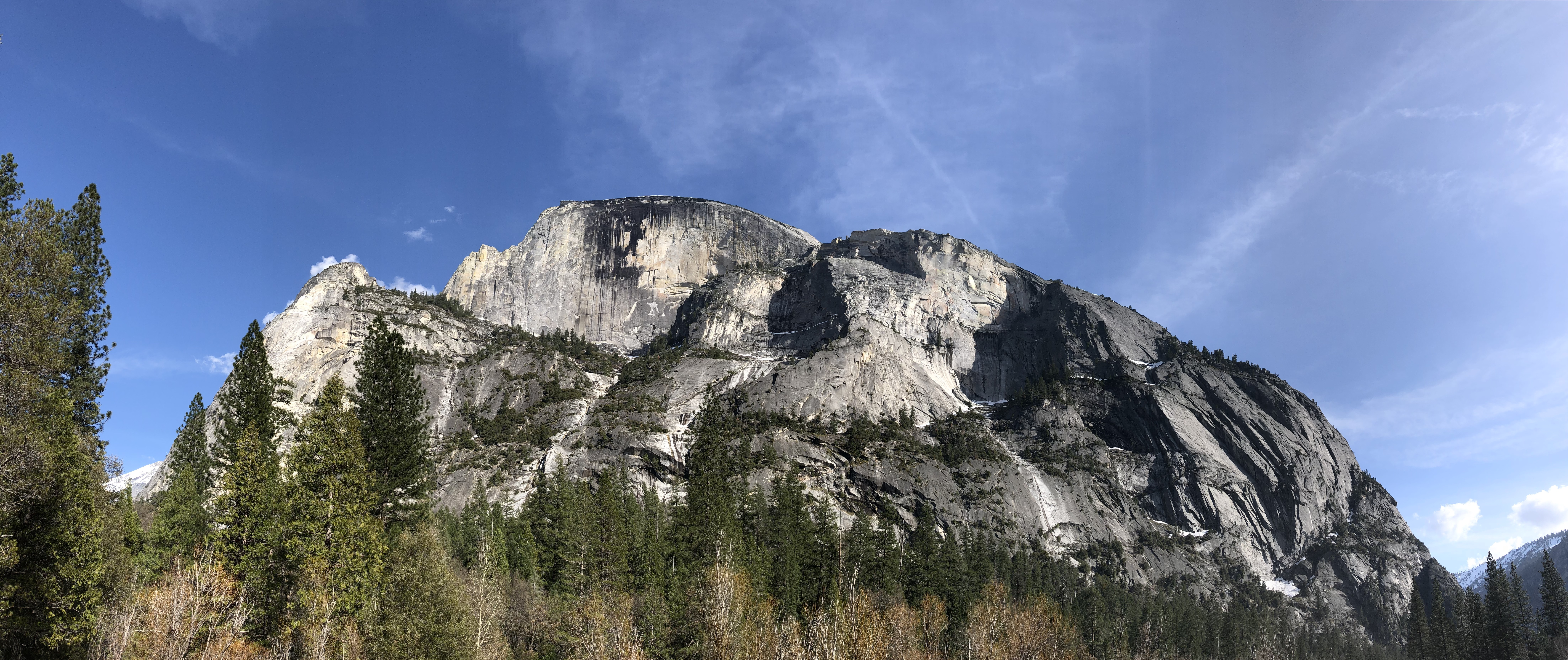 a view of the broad side of Half Dome from Yosemite Valley